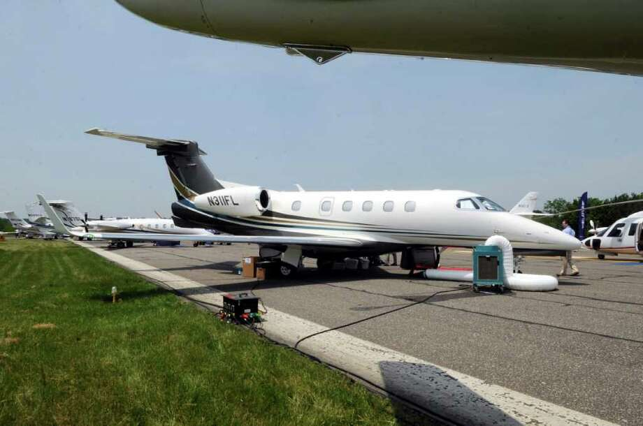 A new private jet, the Embraer Phenom 300, on display at the Westchester County Airport in White Plains, N.Y., on Wednesday, June 8, 2011. Photo: Helen Neafsey / Greenwich Time