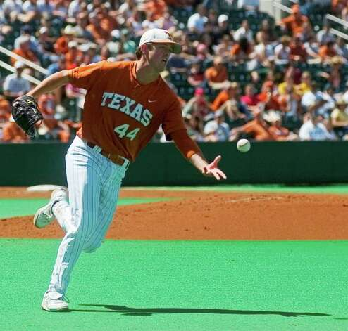 Texas pitcher Austin Wood throws to first after fielding a ball for an out against Baylor a in Austin on  May 3 2008. (AP Photo/American-Statesman, Bret Gerbe) Photo: Bret Gerbe, Longhorns / American-Statesman
