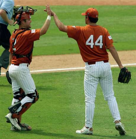 Texas' Brett Lewis (left) and Austin Wood celebrate the teams 7-4 win over Wake Forest in 12 innings on June 3, 2007, at Dell Diamond in Round Rock.  EDWARD A. ORNELAS/EXPRESS-NEWS Photo: EDWARD A. ORNELAS, Longhorns / SAN ANTONIO EXPRESS-NEWS