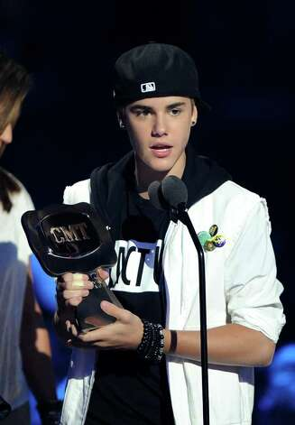 NASHVILLE, TN - JUNE 08:  Musician Justin Bieber accepts Collaborative Video of the Year award on stage at the 2011 CMT Music Awards at the Bridgestone Arena on June 8, 2011 in Nashville, Tennessee. Photo: Jason Merritt, Getty Images / 2011 Getty Images