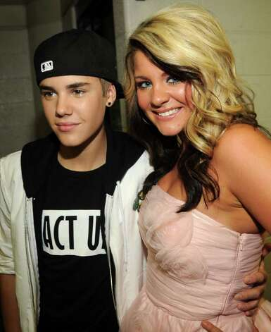 NASHVILLE, TN - JUNE 08:  Musician Justin Bieber and singer Lauren Alaina attend the 2011 CMT Music Awards at the Bridgestone Arena on June 8, 2011 in Nashville, Tennessee. Photo: Rick Diamond, Getty Images For CMT / 2011 Getty Images