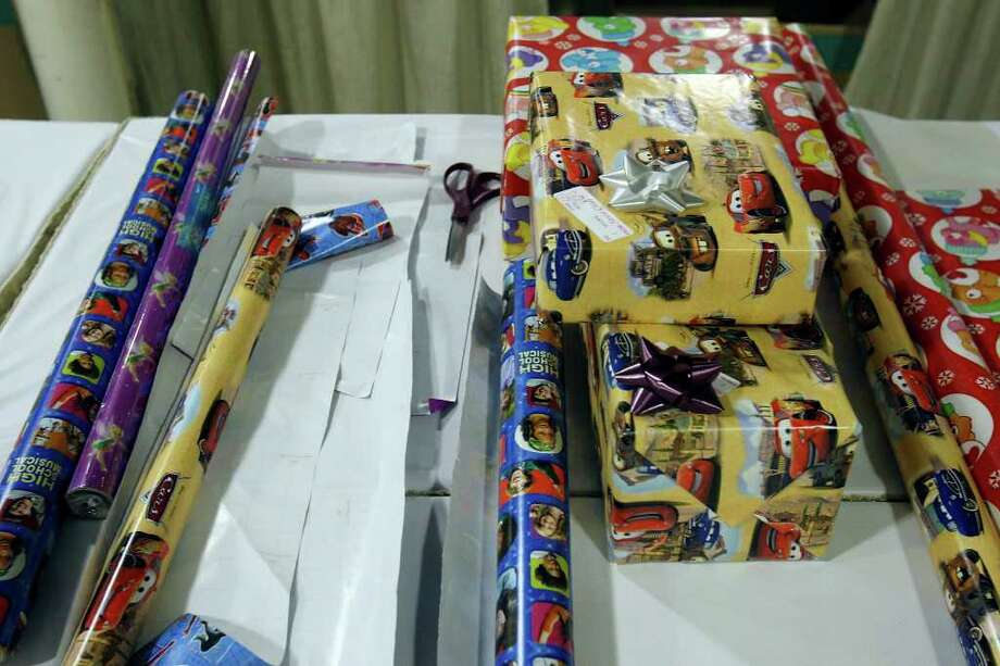 FOR SALIFE - Wrapping paper and wrapped gifts Monday Dec. 8, 2008 part of the Elf Louise Project. (PHOTO BY EDWARD A. ORNELAS/eornelas@express-news.net) Photo: EDWARD A. ORNELAS, SAN ANTONIO EXPRESS-NEWS / eornelas@express-news.net