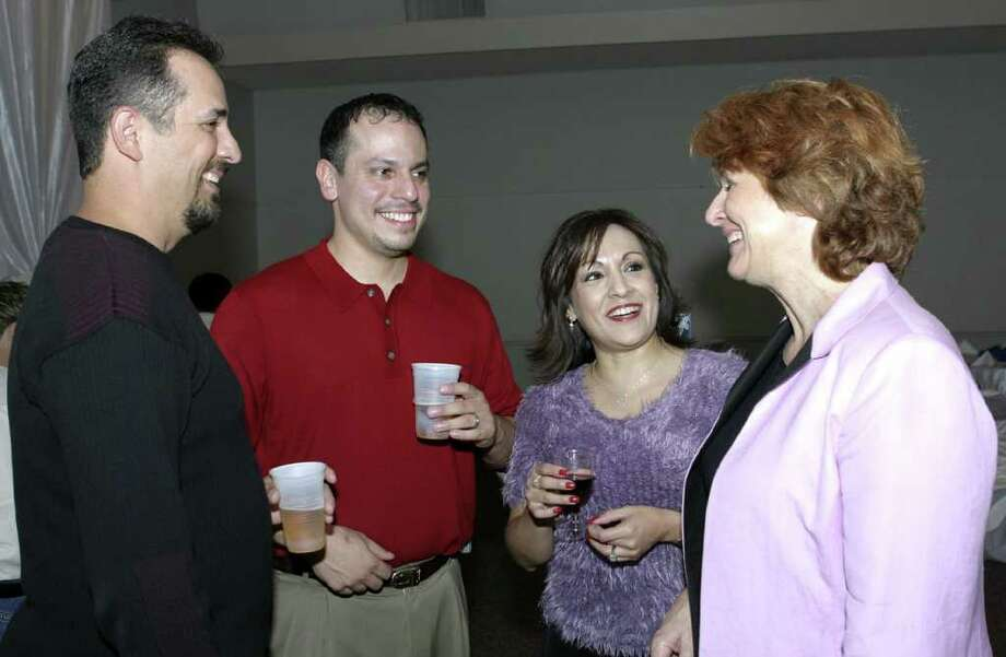 OTS/BROTHERS - Ray Otero (guest), Darryl Flores, Carolyn Flores (chairs, spouses) and Louise Locker (Elf Louise) were at the Firefighters Event Center on 11/18/2004 for the Elf Louise Christmas Fundraiser. names checked photo by leland a. outz Photo: LELAND A. OUTZ, SPECIAL TO THE EXPRESS-NEWS / SAN ANTONIO EXPRESS-NEWS