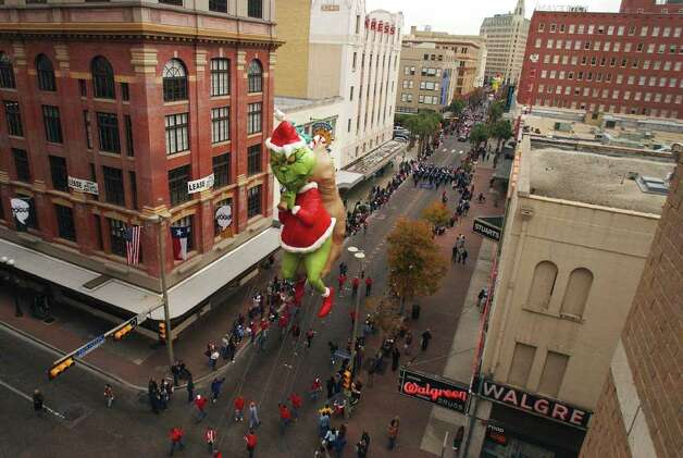 The Grinch floats down Houston St. Saturday, December 7, 2002, during the Children Giving to Children Parade and Toy Drive to benefit the Elf Louise Christmas Project. Photo: BAHRAM MARK SOBHANI, SAN ANTONIO EXPRESS-NEWS / SAN ANTONIO EXPRESS-NEWS