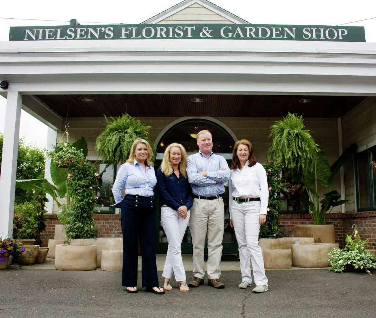 The owners of Nielsen's Florist & Garden Shop, from left, Tami Whittier, Karen Kuehler, Jerry Nielsen and Sandy Nielsen-Baumann.