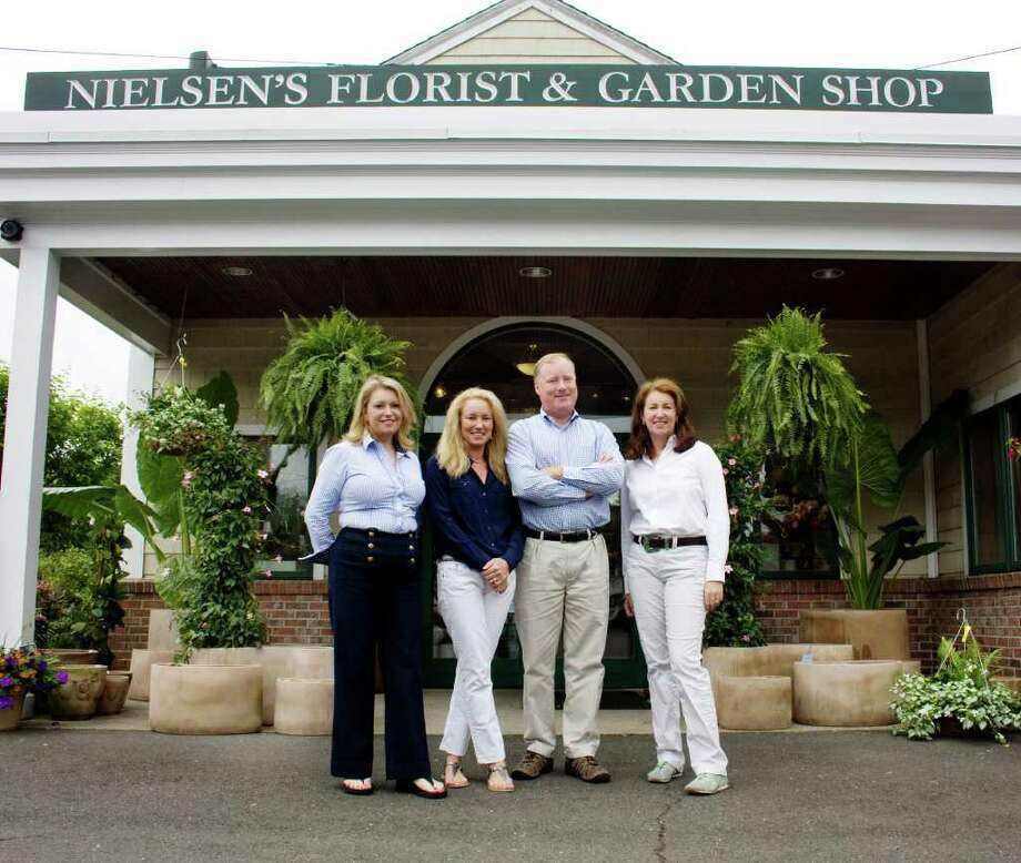 The owners of Nielsen's Florist & Garden Shop, from left, Tami Whittier, Karen Kuehler, Jerry Nielsen and Sandy Nielsen-Baumann. Photo: Contributed Photo / Darien News