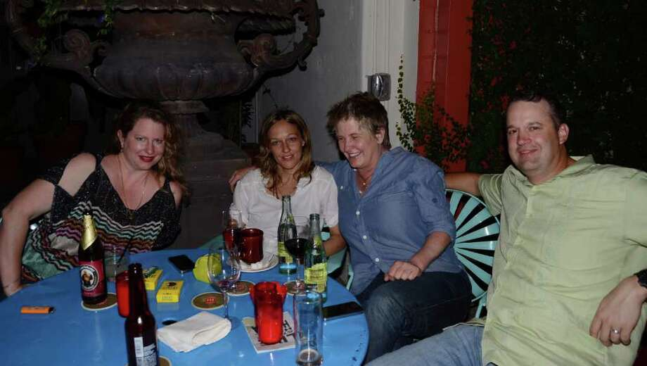 Elizabeth Fauerso (from left), Amy Cook, Liz Lambert (the hotel's owner) and Chris Senn enjoy the outdoor patio of Ocho. ROBIN JOHNSON / SPECIAL TO THE EXPRESS-NEWS