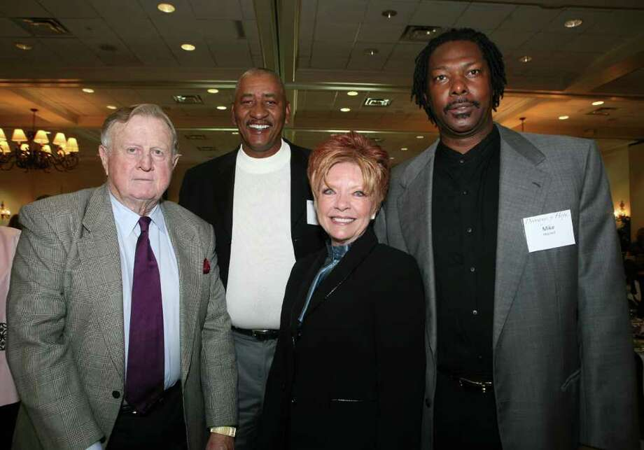 OTS/HEIDBRINK - Red McCombs (Honoree, Speaker), George Gervin (Supporter), Julie Wisdom-Wild (CEO Alpha Home) and Mike Mitchell (Supporter) were at the Alpha Home Luncheon on 11/3/2009 at the San Antonio Country Club. This is #1 of 2 photos. names checked photo by leland a. outz Photo: LELAND A. OUTZ, SPECIAL TO THE EXPRESS-NEWS / SAN ANTONIO EXPRESS-NEWS