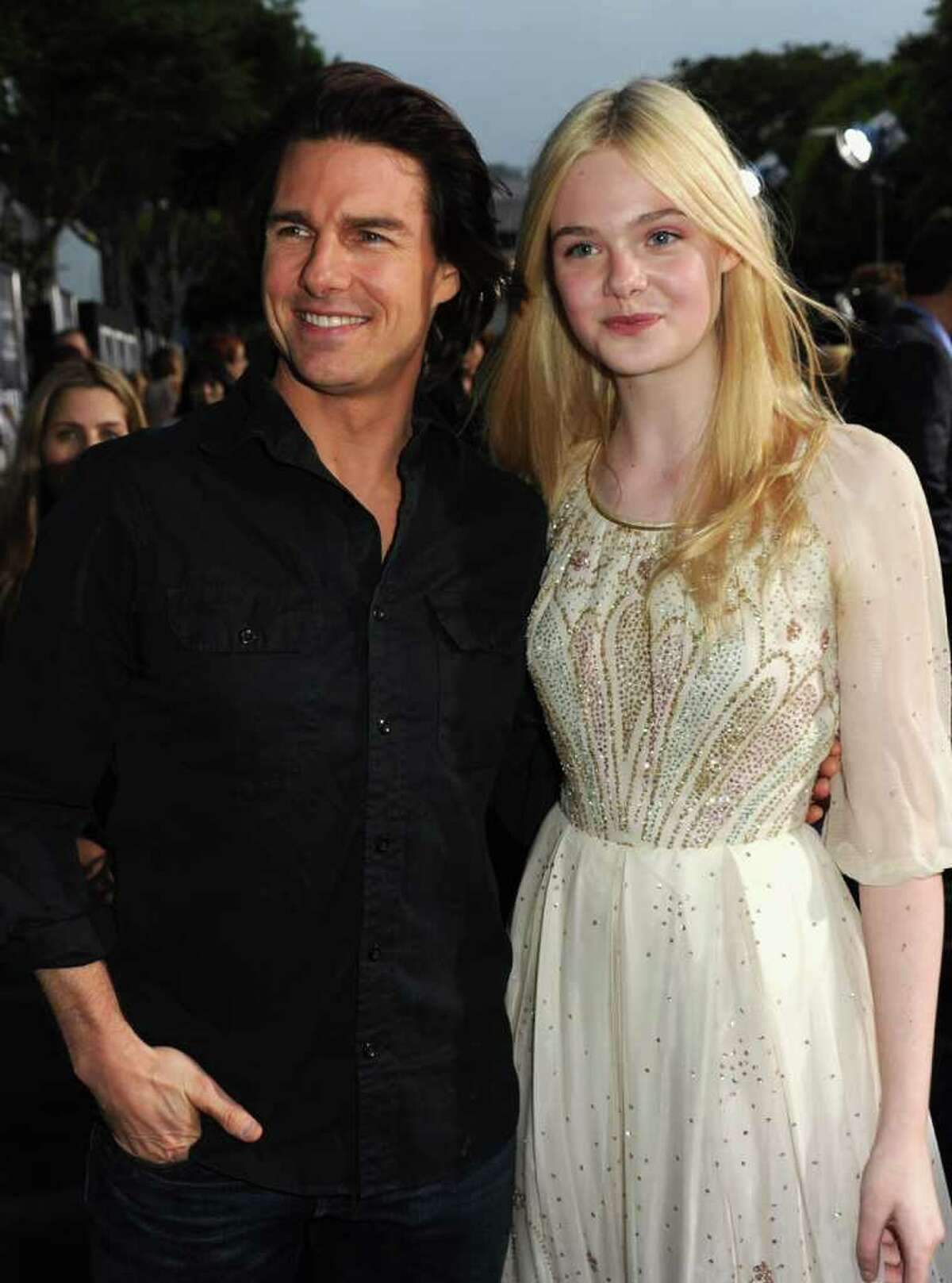 """Actors Tom Cruise and Elle Fanning arrive at the premiere of Paramount Pictures' """"Super 8"""" at Regency Village Theatre in Westwood, California."""