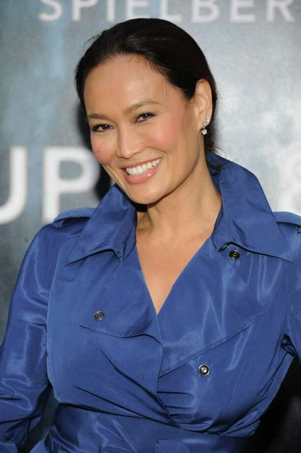 "Actress Tia Carrere arrives at the premiere of Paramount Pictures' ""Super 8"" at Regency Village Theatre in Westwood, California. Photo: Frazer Harrison, Getty Images / 2011 Getty Images"