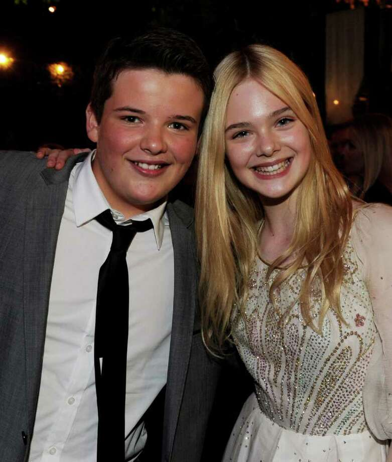 "Actors Riley Griffiths (L) and Elle Fanning pose at the after party for the premiere of Paramount Pictures' ""Super 8"" at the Village Theater in Los Angeles, California. Photo: Kevin Winter, Getty Images / 2011 Getty Images"