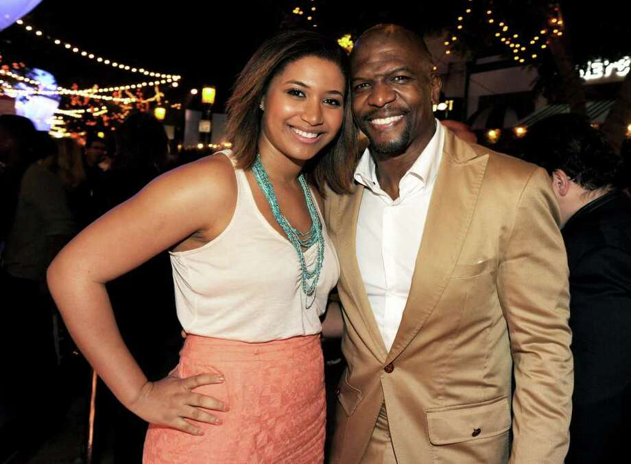 "Actor Terry Crews (R) and his daughter Azriel Crews pose at the after party for the premiere of Paramount Pictures' ""Super 8"" at the Village Theater in Los Angeles, California. Photo: Kevin Winter, Getty Images / 2011 Getty Images"