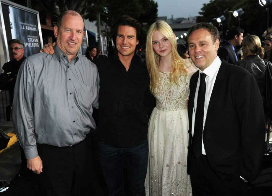 "Paramount Pictures Vice Chairman Rob Moore, actors Tom Cruise and Elle Fanning and producer Bryan Burk arrive at the premiere of Paramount Pictures' ""Super 8"" at Regency Village Theatre in Westwood, California. Photo: Kevin Winter, Getty Images / 2011 Getty Images"
