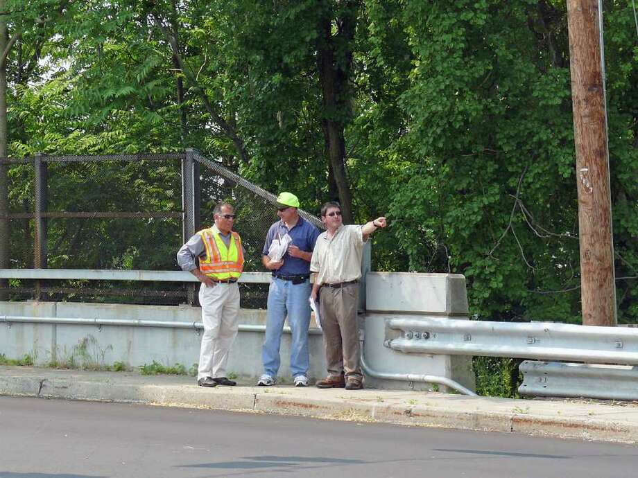 From left, Morteza Hayatgheybi, from VHB, Inc., Joseph Ouellette, supervising engineer with the state Department of Transportation, and Town Engineer William Hurley discuss some of the issues with the new traffic signals at Grasmere Avenue and Kings Highway East. Photo: Genevieve Reilly / Fairfield Citizen