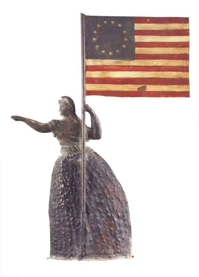 Look closely at the stars shown in any flag used as a design. It may help date it. This rare molded copper Liberty weathervane was estimated to sell for $150,000 to $200,000, but no one bid high enough to buy it. The circle of stars shows it was made in 1867. Photo: Contributed Photo / The News-Times Contributed