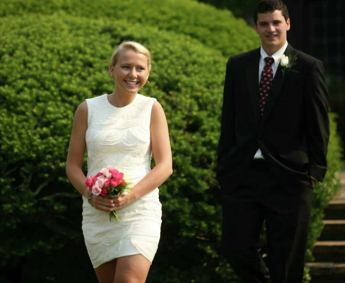 Hayley Brown and Daniel Chase enter theGreens Farms Academy graduation in Westport on Thursday, June 9, 2011.