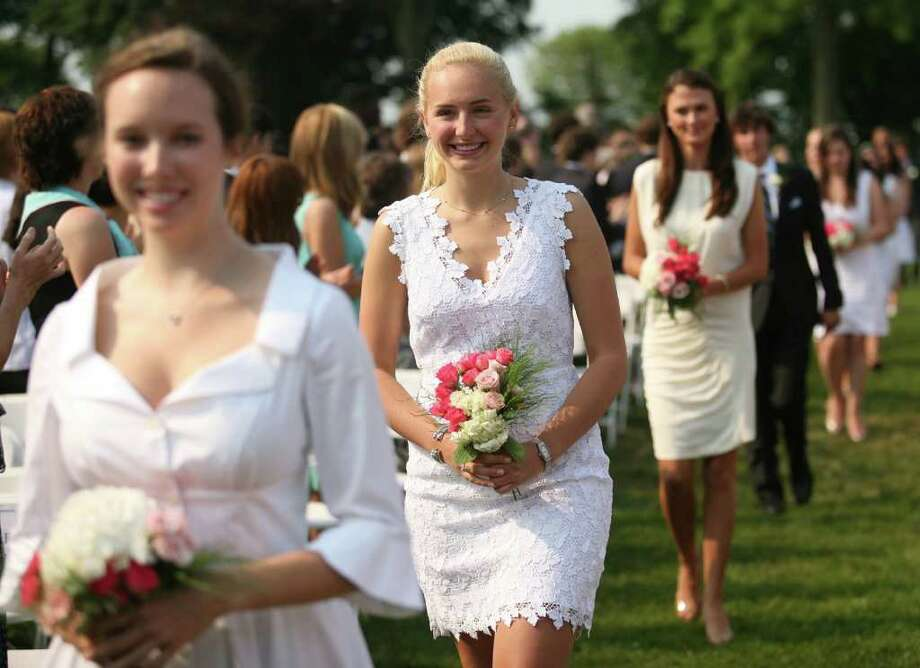 From left; Katrina Crawford, Alexandra Damianos, Elizabeth diBonaventura, and fellow graduates march in to the Greens Farms Academy graduation in Westport on Thursday, June 9, 2011. Photo: Brian A. Pounds / Connecticut Post