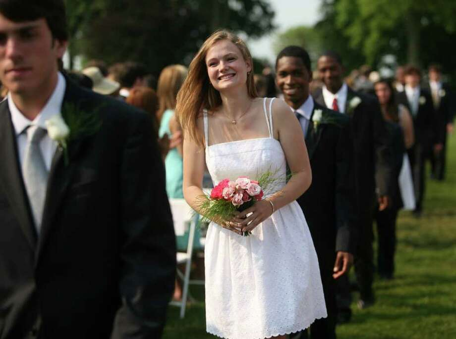 Brooke McGrath smiles as she marches in with her classmates at the Greens Farms Academy graduation in Westport on Thursday, June 9, 2011. Photo: Brian A. Pounds / Connecticut Post