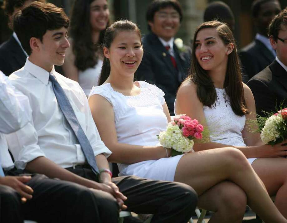 From left; Gregory Tartaglione, Caroline Sullivan, and Alexa Sullivan at the Greens Farms Academy graduation in Westport on Thursday, June 9, 2011. Photo: Brian A. Pounds / Connecticut Post