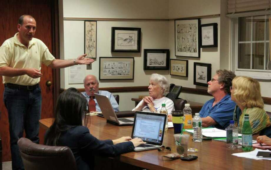 Bart Shuldman discusses his appeal of Text Amendment 625 with members of the Representative Town Meeting's Planning and Zoning Committee on Wednesday, June 8, 2011 at Town Hall. First Selectman Gordon Joseloff sits to the right of Shuldman. Photo: Paul Schott / Westport News