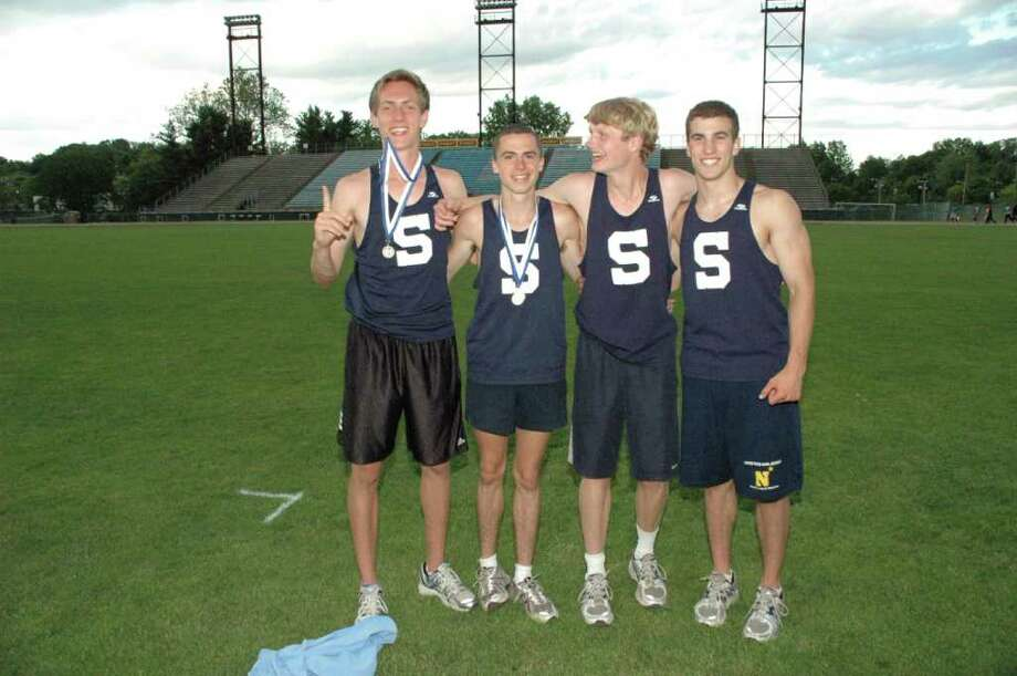From left, Staples sophomore Henry Wynne, senior captain Jack Roche, sophomore Walker Marsh and senior captain Sean Gallagher won the 4x800 meter relay at State Open Monday and qualified for tomorrow's New England championships while breaking a 21-year old school record. Photo: Contributed Photo / Staplesrunning.com