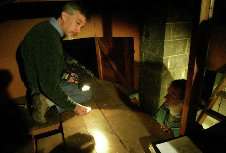 Tom Balderston, building performance consultant with Conservation Services Group, discusses the quality of the insulation in the attic of Don Farrell, right, during an inspection of his home June 6, 2007. Such inspections often recommend adding insulation and weatherization. Photo: ANDY ROGERS, Seattle Post-Intelligencer / Seattle Post-Intelligencer