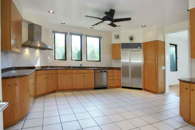 The Kitchen Has Been Updated And Features A White Ceramic Tile Floor