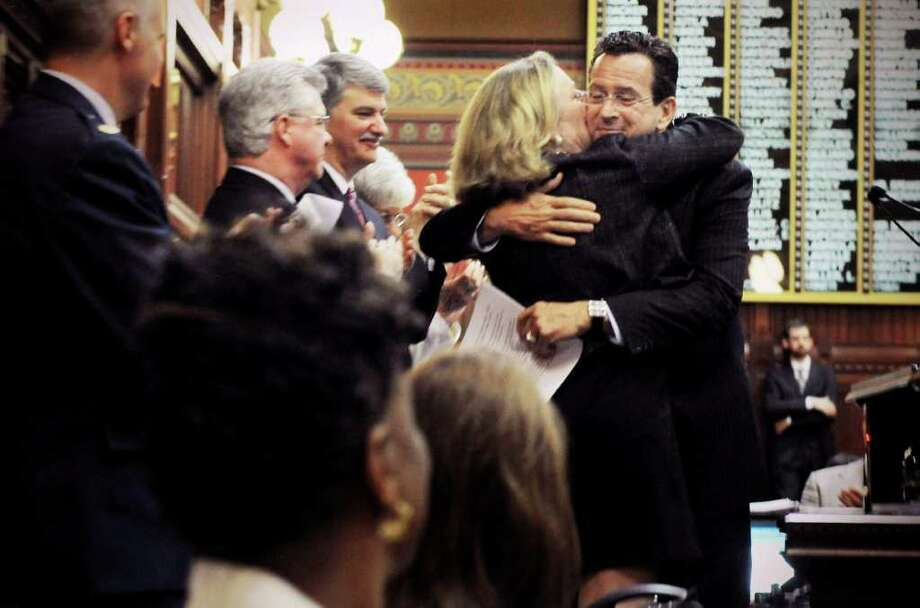Connecticut Gov. Dannel P. Malloy and his wife, Cathy Malloy, embrace after he spoke to the House of Representatives and the Senate at the closing of session at the Capitol in Hartford, Conn., Wednesday, June 8, 2011. Photo: Kathleen O'Rourke, Stamford Advocate / Stamford Advocate
