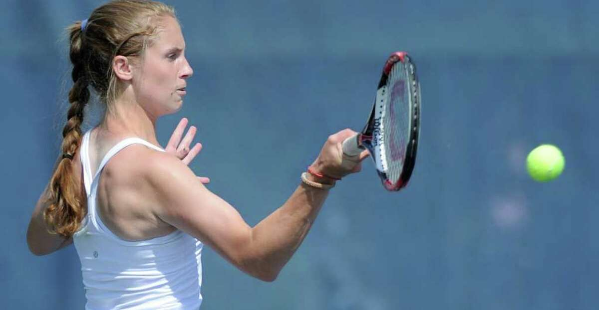 Kimmy Guerin of Weston High School in match against Courtney Gallagher of New Canaan High School during State Open Tennis Semifinals at Yale University, New Haven, Tuesday afternoon, June 7, 2011.