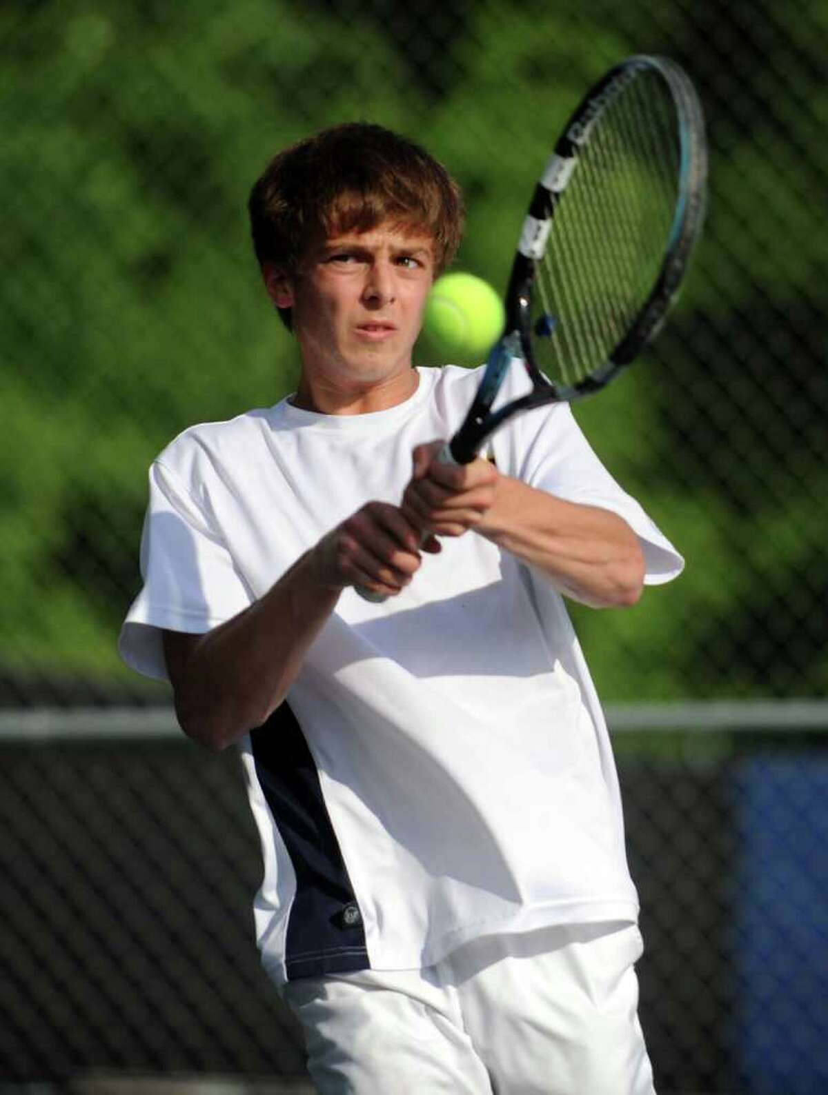 Weston's Josh Simon returns the ball during his doubles match against Pomperaug in the SWC finals Wednesday, May 25, 2011 at Weston High School.