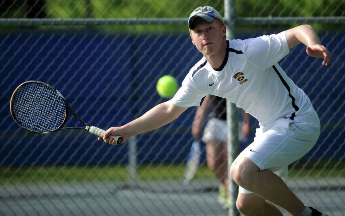 Weston's Cam Hagen returns the ball during his singles match against Pomperaug in the SWC finals Wednesday, May 25, 2011 at Weston High School.