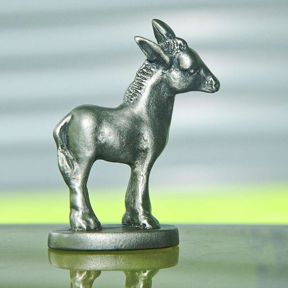 The  Silver Donkey award can be used as a small statuette or a lapel pin, according to the preference of the recipient. Photo: Contributed Photo
