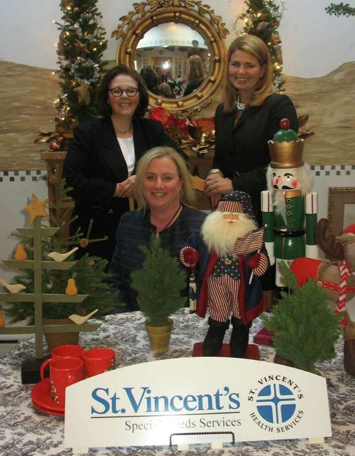 Pictured are the Fairfield Christmas Tree Festival's tri-chairwomen Carol Timpanelli and Christine Brown, standing from left to right, and Christina Longden, sitting. Photo: Contributed Photo
