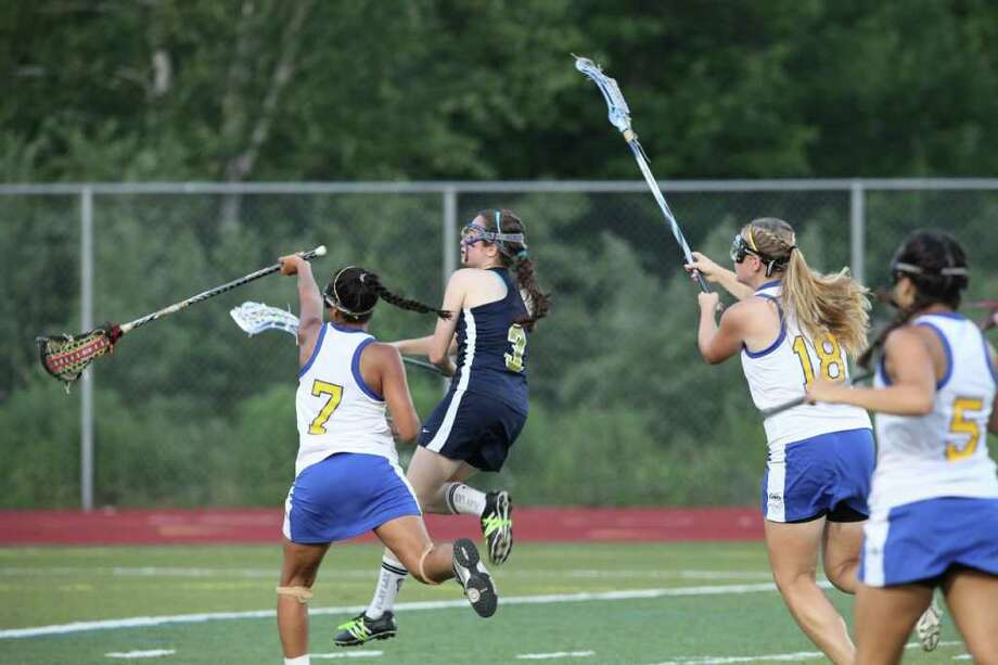 Weston senior tri-captain Cara Fleming fires a shot against Haddam-Killingworth Wednesday in the Class S semifinals. Fleming scored the goal that turned the tide in the Lady Trojans' 12-7 victory. Photo: Contributed Photo / Vivian Simons