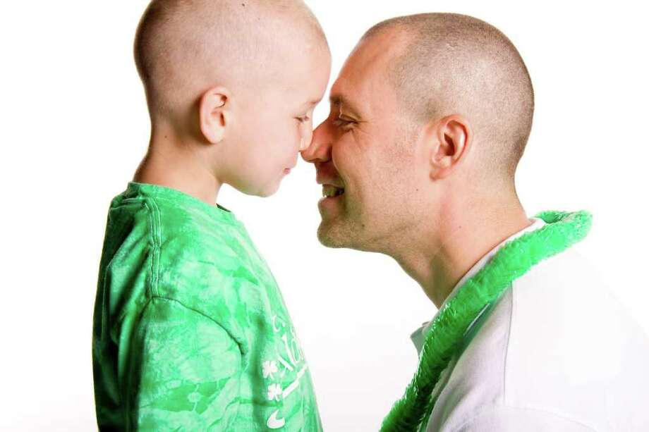 Brent McCreesh goes nose to nose with his father, Michael, after a St. Baldrick's Day hair-shearing event in April to raise money for cancer research. Cancer-free for five years, it was Brent's first time being sheared, his dad's seventh. Photo: Contributed Photo / Fairfield Citizen contributed