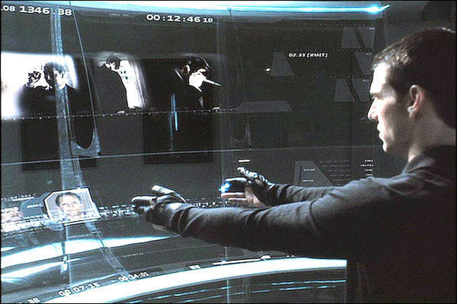 """Precrime detective John Anderton (Tom Cruise) uses his hands to use a futuristic computer in """"Minority Report."""" Photo: Promotional Image / 20th Century Fox"""