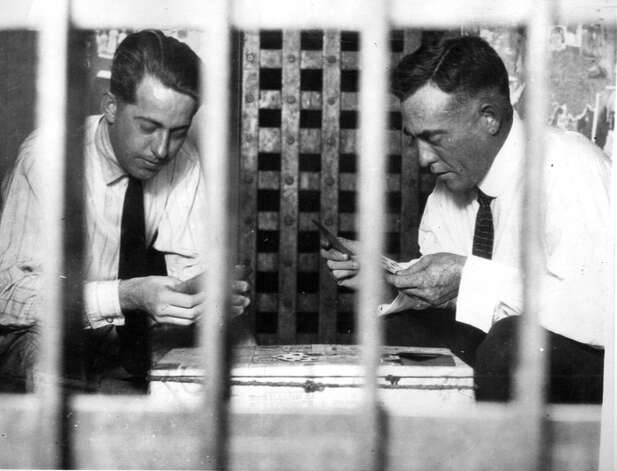 Roy Gardner, right, shown in his Phoenix, Ariz., jail cell, April 1922. He was waiting for trial. Photo: Seattlepi.com File