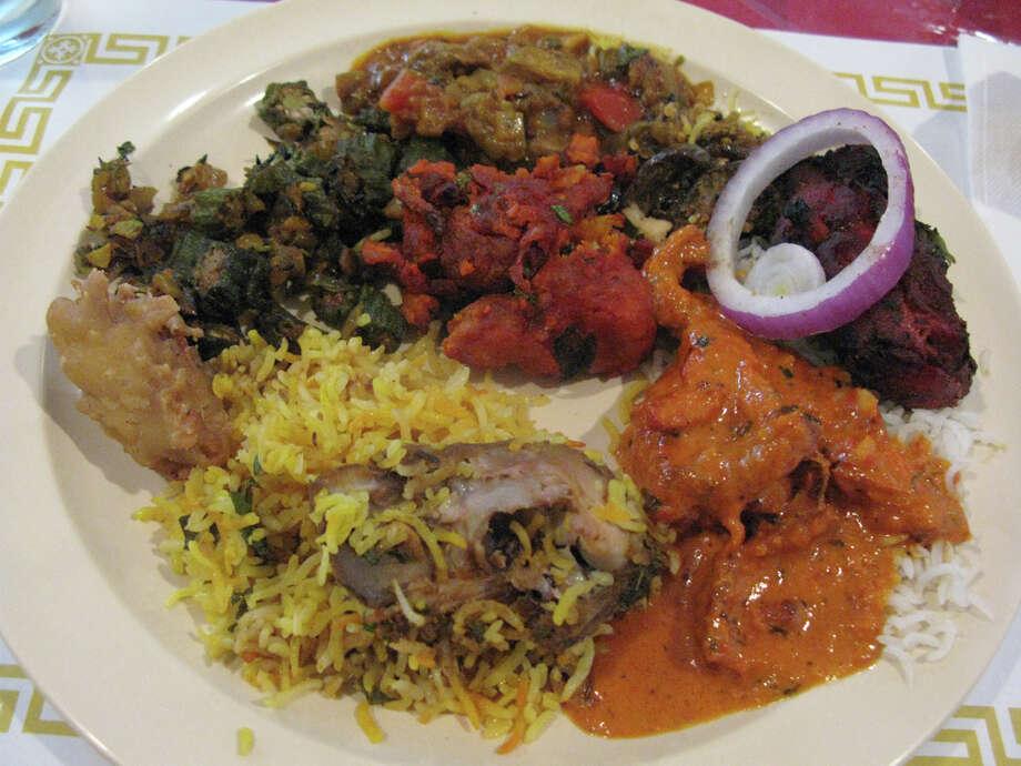 A selection from the buffet at Mustafa Restaurant. JENNIFER McINNIS / EXPRESS-NEWS