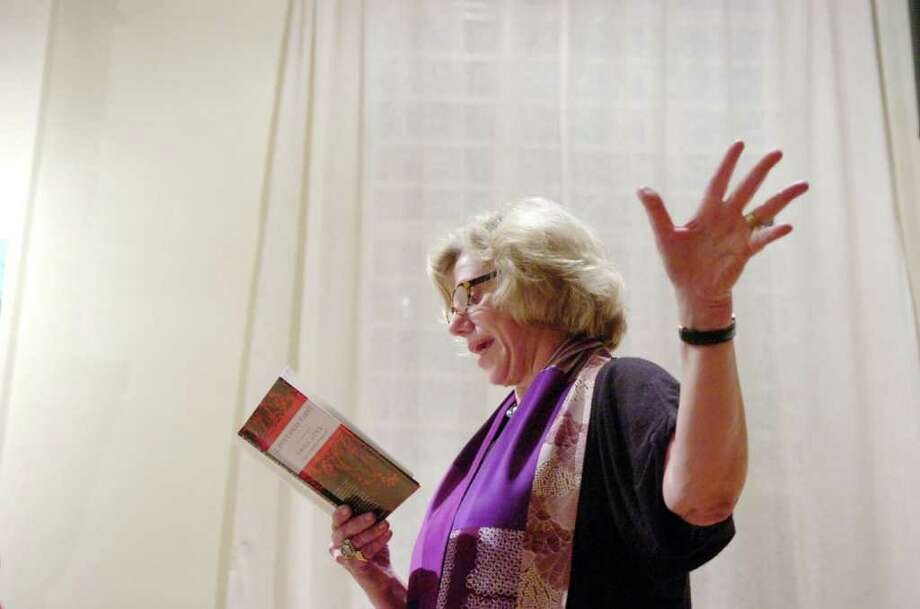"At a 2009 appearance at Arcadia in Old Greenwich writer Erica Jong reads poems from her book, ""Loves Comes First"". Photo: Keelin Daly / Greenwich Time"