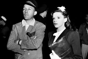 """Singer-actor Bing Crosby, left, visits singer-actress Judy Garland on the set of """"The Harvey Girls"""" in Hollywood, Ca., in 1945."""