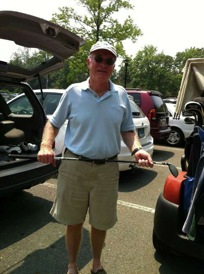 Old Greenwich resident Jim Bulger played 18 holes at the Griffith E. Harris Golf Course on Thursday, June 9, 2011, despite recent sightings of a mountain lion nearby. Photo: Lisa Chamoff / Greenwich Time