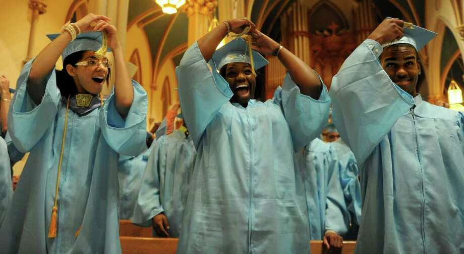 Graduates move their tassels during Thursday's graduation ceremony for Kolbe Cathedral High School Seniors at St. Augustine Cathedral in Bridgeport on June 9, 2011. Photo: Lindsay Niegelberg / Connecticut Post