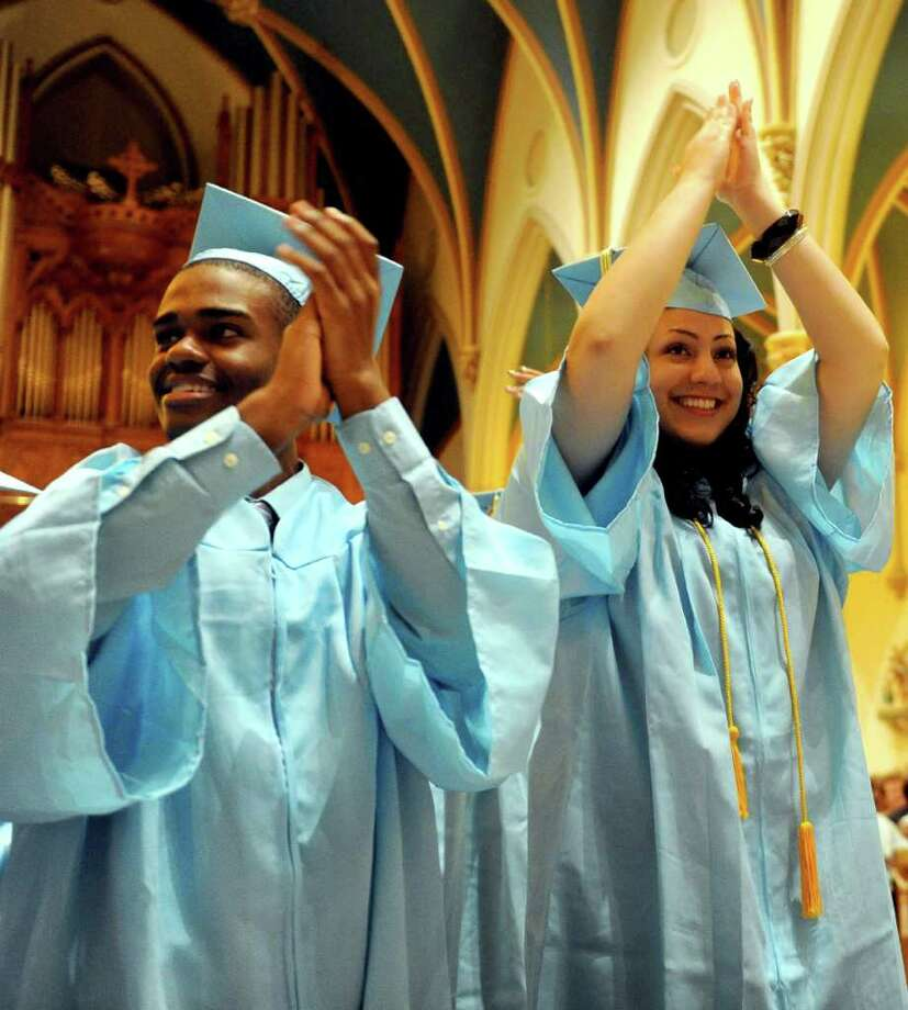 Graduates cheer after moving their tassels during Thursday's graduation ceremony for Kolbe Cathedral High School Seniors at St. Augustine Cathedral in Bridgeport on June 9, 2011. Photo: Lindsay Niegelberg / Connecticut Post