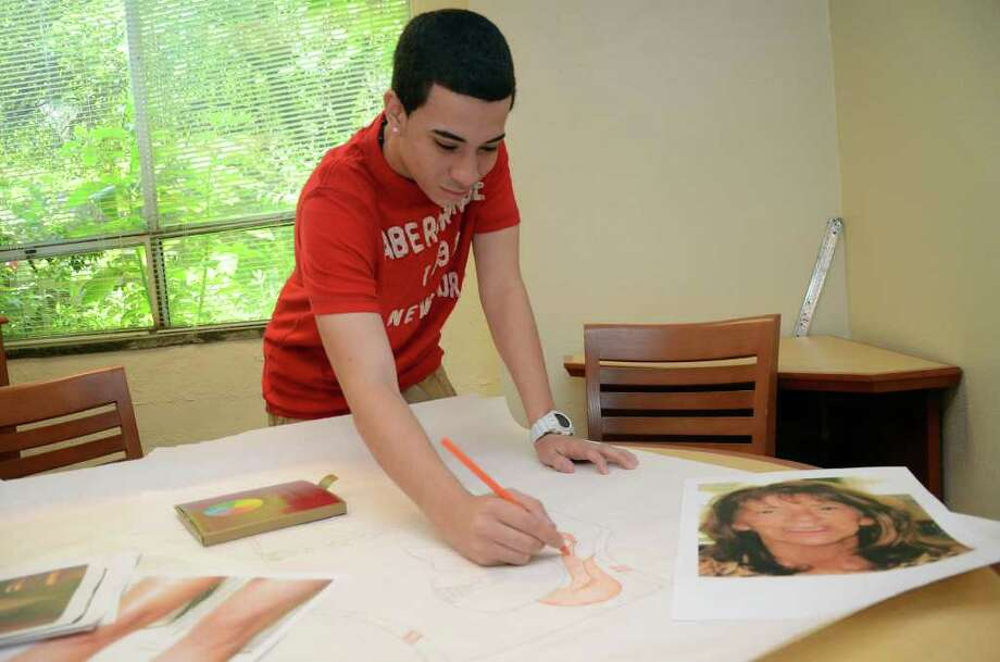 Stamford High School sophomore, Joe Pastrana, works on a life-sized two-dimensional model of his Principal, Donna Valentine, as an extra credit project for math class in the school's library on the morning of Tuesday, June 7, 2011. Pastrana's math teacher Debbie Chaikind is overseeing the project. Photo: Amy Mortensen / Connecticut Post Freelance