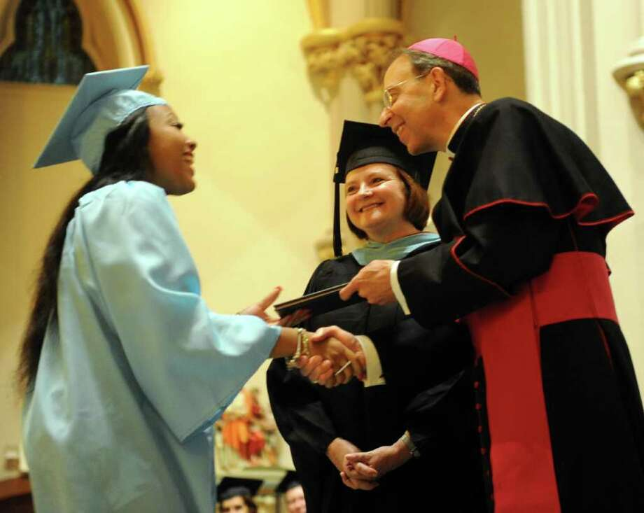 Christine Austin-Curry gets her diploma during Thursday's graduation ceremony for Kolbe Cathedral High School Seniors at St. Augustine Cathedral in Bridgeport on June 9, 2011. Photo: Lindsay Niegelberg / Connecticut Post