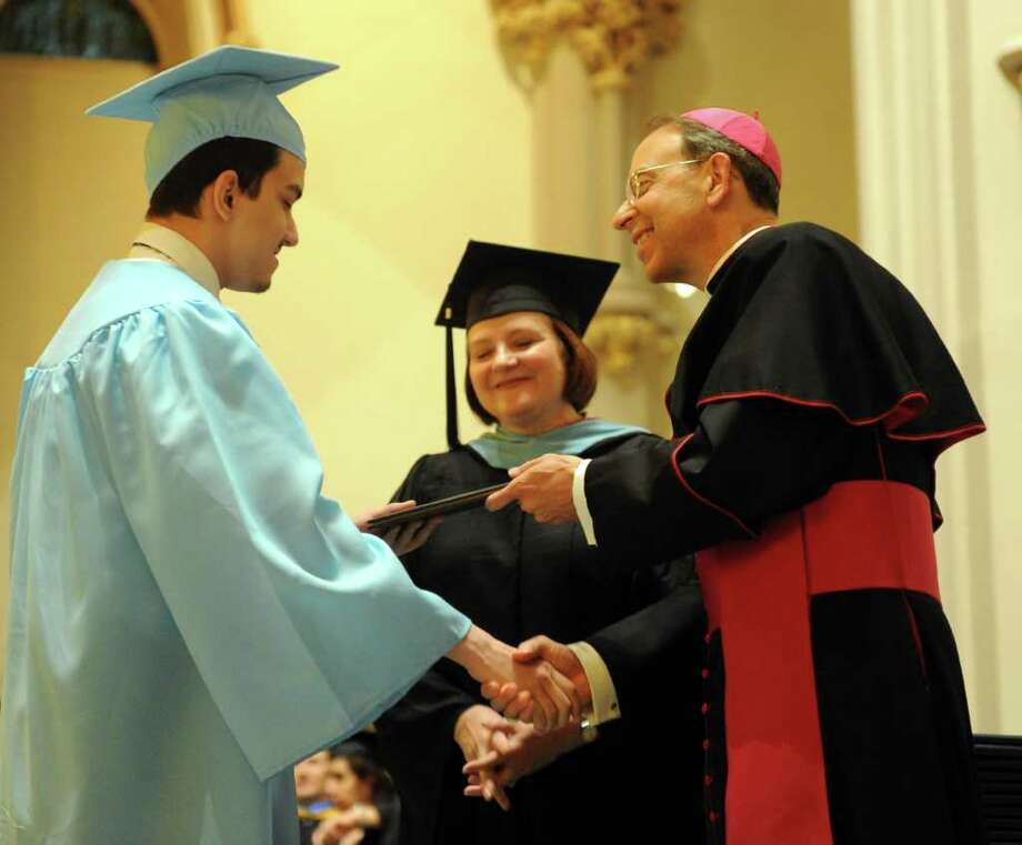 Brandon Batista gets his diploma during Thursday's graduation ceremony for Kolbe Cathedral High School Seniors at St. Augustine Cathedral in Bridgeport on June 9, 2011. Photo: Lindsay Niegelberg / Connecticut Post