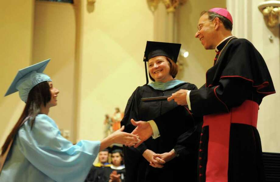 Karla Bonilla gets her diploma during Thursday's graduation ceremony for Kolbe Cathedral High School Seniors at St. Augustine Cathedral in Bridgeport on June 9, 2011. Photo: Lindsay Niegelberg / Connecticut Post