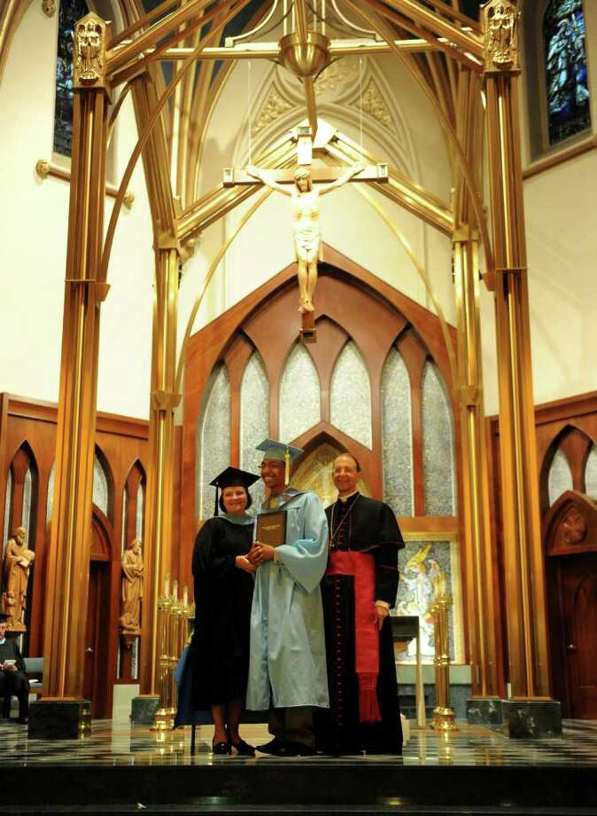 Stephen Soto gets his diploma during Thursday's graduation ceremony for Kolbe Cathedral High School Seniors at St. Augustine Cathedral in Bridgeport on June 9, 2011. Photo: Lindsay Niegelberg / Connecticut Post