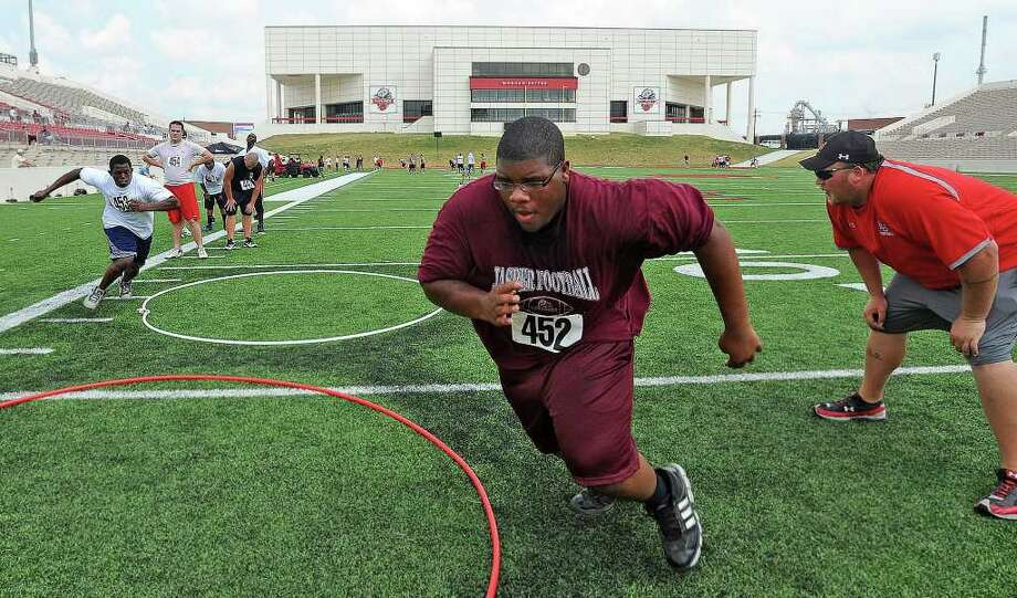 Young athletes run around rings during Lamar's summer football camp on Thursday. Guiseppe Barranco/The Enterprise