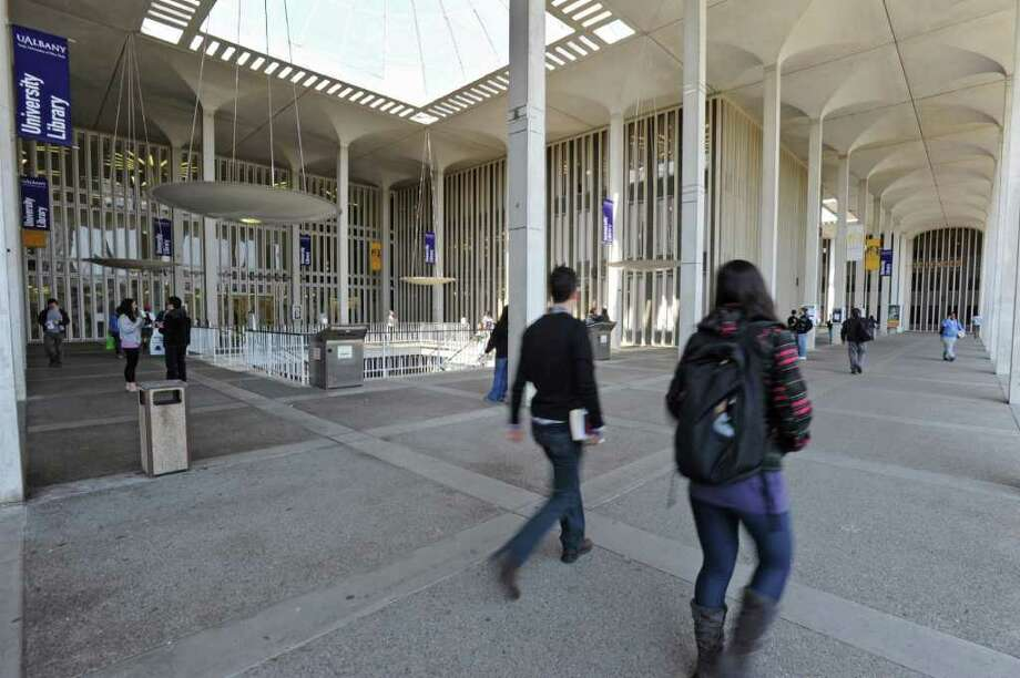 Students walk outside the library at UAlbany in Albany, N.Y. on Thursday April 14, 2011. (Lori Van Buren / Times Union) Photo: Lori Van Buren